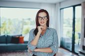 Young Confident Smart Woman Posing In Living Room Indoors poster