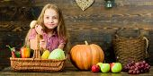 Child Girl Presenting Harvest Of Her Vegetable Garden On Wooden Background. Harvest Festival Concept poster