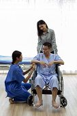 Physical therapist explain treatment method to senior patient and relative poster
