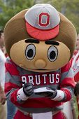 Brutus the Buckeye at Ohio State signs an autograph for a fan