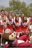 Ohio State cheerleaders pose with Brutus the mascot