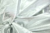 stock photo of lame  - silver lame fabric background - JPG