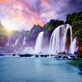 stock photo of bans  - Banyue or Ban Gioc waterfall along Vietnamese and Chinese board - JPG