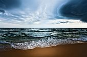 Beautiful beach and dramatic sky. Stormy weather