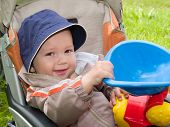 smiling boy in stroller