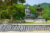 Giant statue of Buddha and memorial plates in the Sinheungsa Temple in Seoraksan National Park, Sout