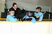 Hockey Coach On Bench With Players