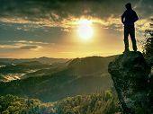 Man Walking On The Edge Of A Cliff At Summit. Hrensko Range,  Czech Republic 21st Of Seprtember 2018 poster