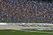 FORT WORTH, TX - APR 19: Tony Stewart leads the pack for the start at the Texas Motor Speedway for t