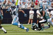 CHARLOTTE, NC - SEPT 13:  Carolina Panthers Running Back, DeAngelo Williams, runs against the Philad