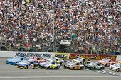 BROOKLYN, MI - JUNE 13:   The NASCAR Spint Cup cars take the green flag for the Heluva Good! Sour Cr