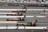 CONCORD, NC - MAR 28:  Joe Hartley, Doug Kalitta, Cor McClenathan, and Tony Schumacher race down the
