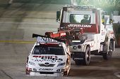 HAMPTON, GA - SEP 05:  Denny Hamlin's Toyota gets towed back in the garage area after blowing up dur