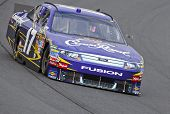 LOUDON, NH - SEP 18:  Matt Kenseth brings his Crown Royal Ford through the turns during practice for