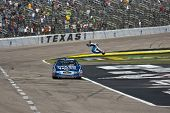 FORT WORTH, TX - NOV 06:  Carl Edwards holds off Kyle Busch and the rest of the field to win the O'R
