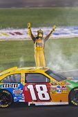 SPARTA, KY - JULY 09:  Kyle Busch (18) wins the Quaker State 400 race at the Kentucky Speedway in Sp