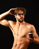 Man Smart And Sexy With Beard And Tousled Hair Wears Eyeglasses. Man Sexy Muscular Torso Offer Cup O poster