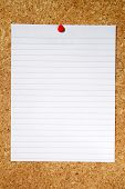 White lined paper pinned to a cork notice board.