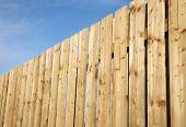 Wooden perimeter fence.