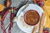 A Cup Of Coffee With Chili. Hot Steaming Cup Of Coffee. Autumn Fall Leaves. poster