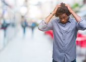 Afro american man over isolated background suffering from headache desperate and stressed because pa poster