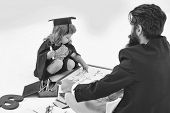 Cute Boy Little Child In Black Academic Squared Hat And Gown Sitting With Bearded Teacher Playing An poster