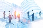 Silhouettes Of Business People Standing On World Map Over Cityscape Background. Global Work Market A poster