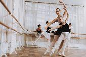 Ballet Training Of Group Of Girls With Teacher. Classical Ballet. Girl In Balerina Tutu. Training In poster