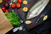 Fish With Ingredients - Healthy Food, Diet Or Cooking Concept. Whole Raw Fish On Dark Vintage Textur poster