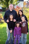 picture of racial diversity  - Family of 5 made of diverse nationalities outdoors - JPG