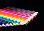 Colorful Pencils Row Isolated On Black