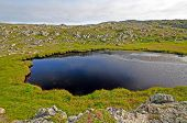 Small Tarn On A Remote Hillside