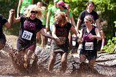 Women Splash Around In Mud Pit Of Obstacle Course Run