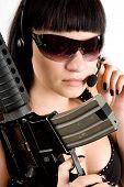 Girl With Gun And Headphones