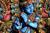 stock photo of hindu-god  - Colorful Wooden Hindu Statue of lord krishna - JPG