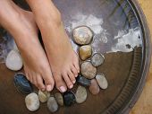 stock photo of foot massage  - foot treatment - JPG
