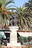 stock photo of luka  - War memorial and palm trees in Vala Luka Croatia - JPG