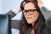 Stressed businesswoman overcharged with work in glasses