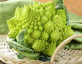 stock photo of romanesco  - Romanesco cauliflower cabbage on a wicker tray - JPG