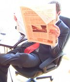 Executive Reading The Newspaper