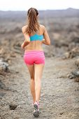 Trail runner woman running cross-country run training outside for marathon. Jogging female athlete w