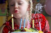 image of happy birthday  - little girl blowing birthday candles - JPG