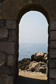 Old Arch With Sea And Rocks In Cefalu
