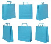 Various blue shopping bags on different possitions