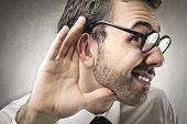 curious businessman listens