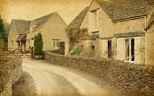 Bibury - Village in Gloucestershire,  England, UK. Photo in retro style. Paper texture.