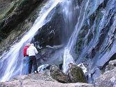 Tourists At Waterfall