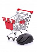 E-commerce and online shopping concept shopping cart and computer mouse