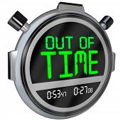 A stopwatch with the words Out of Time representing a deadline that is approaching or has passed and that you have run out of opportunity to complete or finish a test, project or sporting event