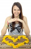 stock photo of 16 year old  - One teenage girl 16 years old caucasian appearance laid out on the table the heart of dandelion flowers - JPG
